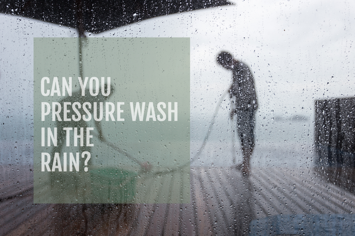 image of people pressure washing in the rain on a deck